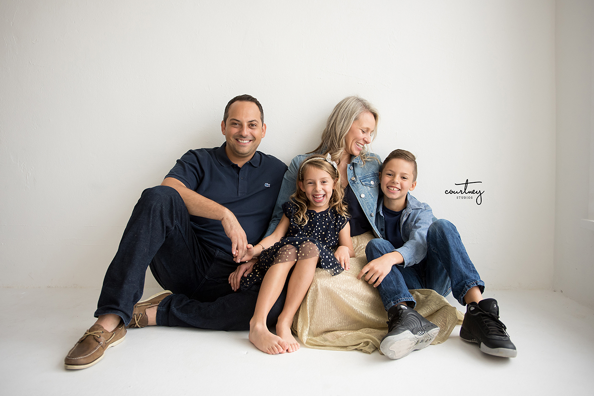 laughing sitting family portrait photography miami family photographer