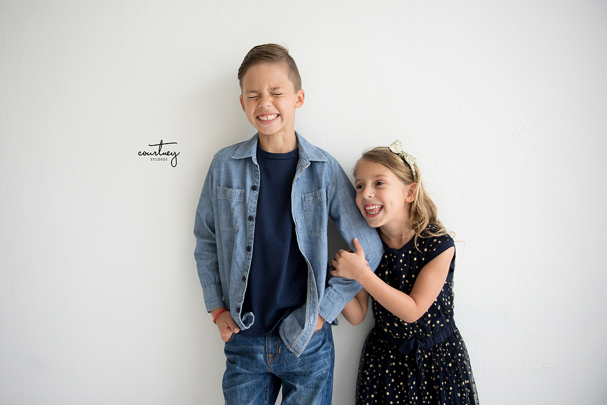 laughing brother sister portrait photography miami family photographer